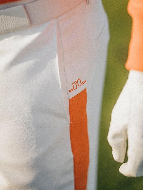 J Lindeberg Golf Trousers Orange Side Stripe